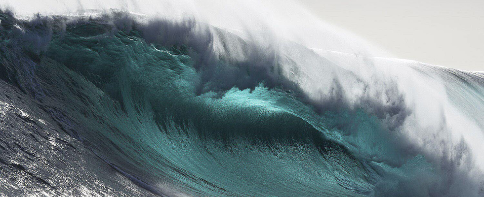 DOCU_GRUPO Australian surfer Paradisis rides a wave near Pedra Branca Rock, south of Tasmania in the Southern Ocean